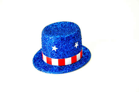 A top hat made of blue glitter decorated in a patriotic theme.