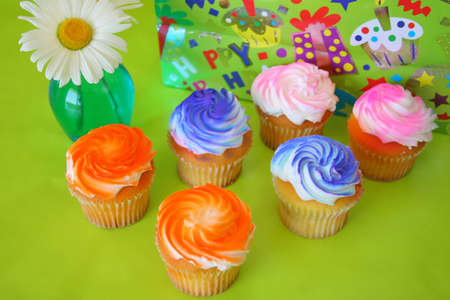 6 cupcakes with bright colors of icing. photo