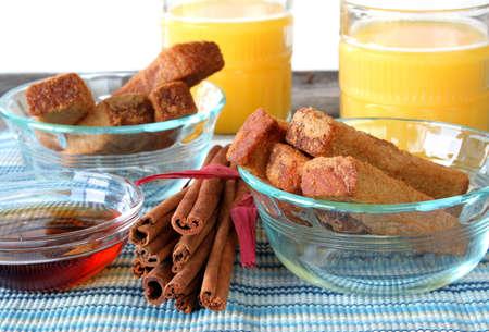 oj: French toast sticks, with fresh oj, cinnamon sticks, and syrup. Stock Photo