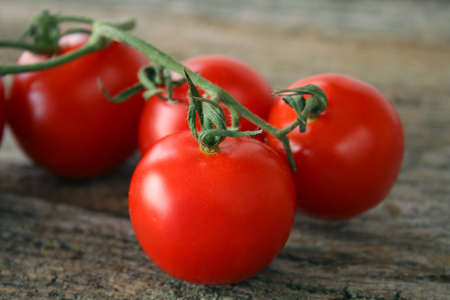 Vine tomatoes that are fresh, ripe and ready to be eaten or used. photo