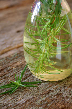 The Herb Rosemary infused in a bottle of olive oil.