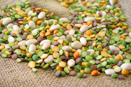 lima bean: An assortment of beans for bean soup all on a burlap background.