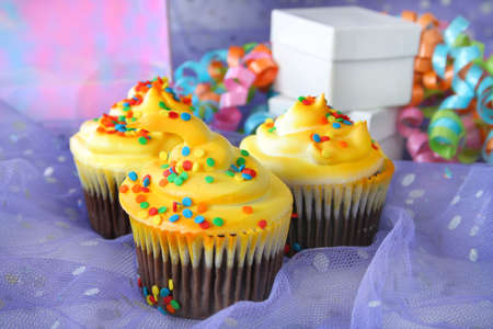 Cupcakes with bright colors and party surroundings. Stock Photo - 3416111