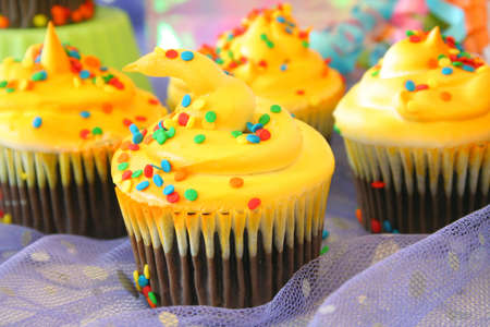 Close up of a cupcake with more cupcakes in the background. Stock Photo - 3435509