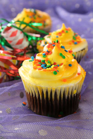 cupcakes with yellow frosting and sprinkles. Stock Photo - 3435510