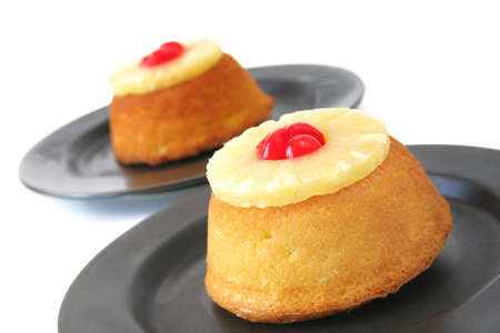 Pineapple upside down cakes isolated on white.