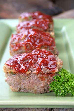 Mini individual meatloafs .  photo