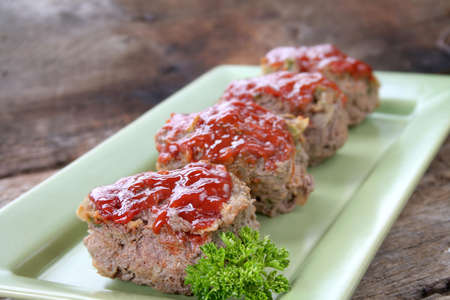 Mini Meat loafs on a tray with parsley. photo