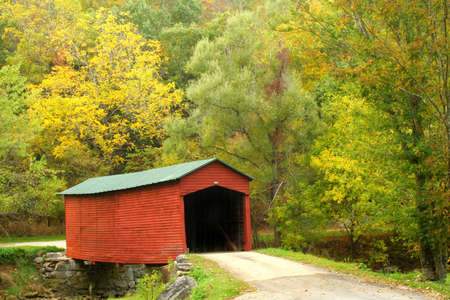 An old covered bridge in early fall.