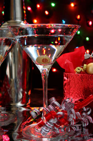 Martini with an olive in a low light image. Perfect for Christmas or New Years ad. Stock Photo