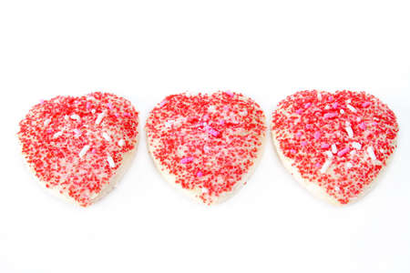 Three heart shaped cookies isolated on a white background. photo