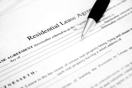 Lease agreement with pen. Used selective focus and shallow Depth of field. photo