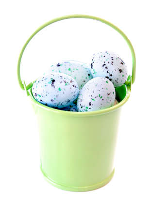 Lime green bucket full of Easter eggs isolated on a white background. photo