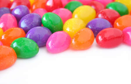 Colorful jelly beans on a white background with copy space. Stock Photo - 4351926