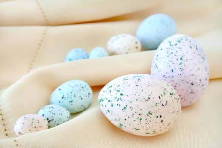 speckle: Colorful Easter eggs on a cloth background.