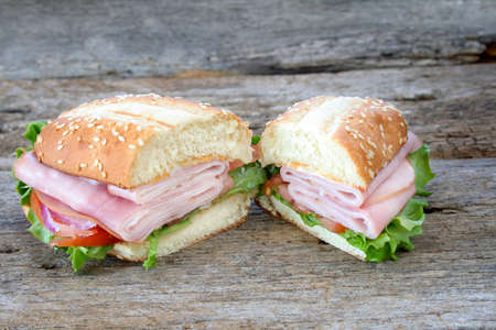 Ham subhoagie with all the fixings and cut in two.  Room for copy space. photo