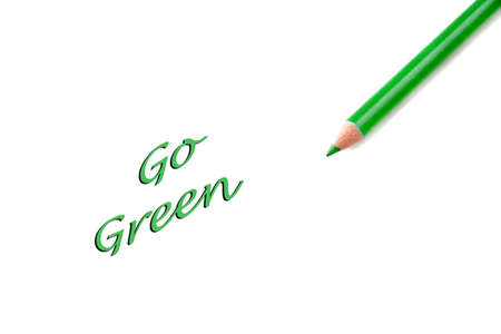 going green: Concept of going green and saving the world.  Words are an illustration and the pencil a photo to create the idea.