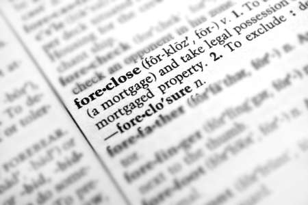foreclose: Close up of the word foreclose,  a great image for our times during the recession. Stock Photo