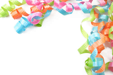 Colorful ribbon curls on a white background as a boarder.  Room for text.