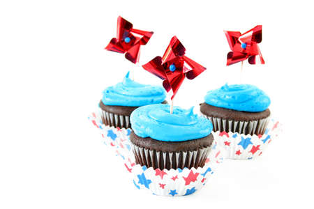 Chocolate cupcakes with blue icing and star cupcake holders  to celebrate several USA holidays. Stock Photo - 4889557