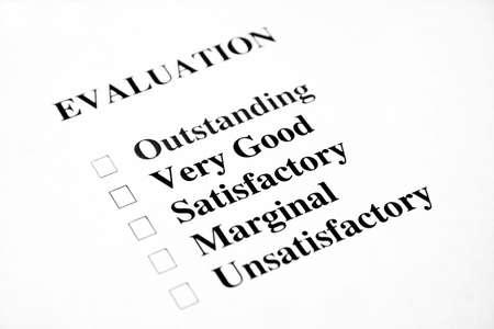 grading: Evaluaci�n en blanco con el foco est� sobre las palabras muy buenas y satisfactorias. Foto de archivo