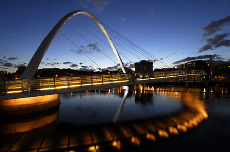 quayside: Gateshead Millenium Bridge and Newcastle Quayside at Night Stock Photo