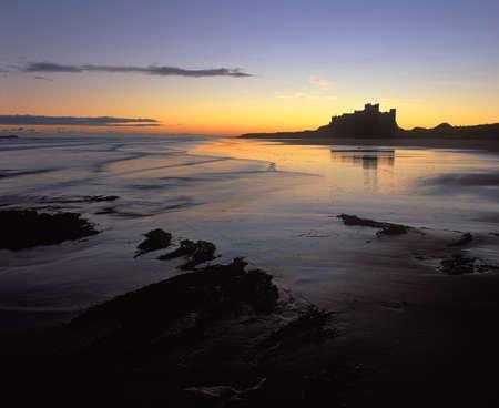 Bamburgh Castle at sunrise Stock Photo - 10780995