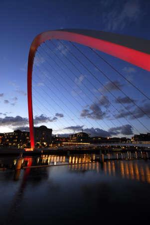 Gateshead Millenium Bridge and Newcastle Quayside at Night Stock Photo