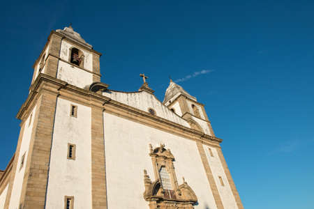 The Church of Santa Maria da Devesa rises into the sky Stock Photo