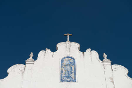 A ceramic azulejo of the virgin Mary adorns the faade of a small country church in Alentejo