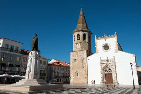 The Church of Sao Joao Batista stands facing the statue of the medieval crusader Gualdim Pais in the main square of Tomar