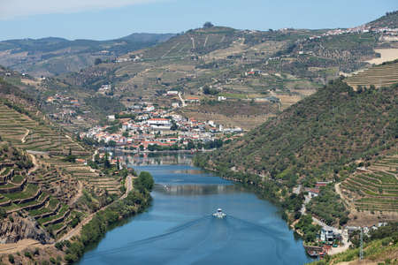 cropland: The Douro River winds through the vineyards of the Douro Valley to the village of Pinhao.