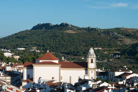 A side view of the Church of Santa Maria da Devesa set against the hills of Castelo de Vide. Stock Photo