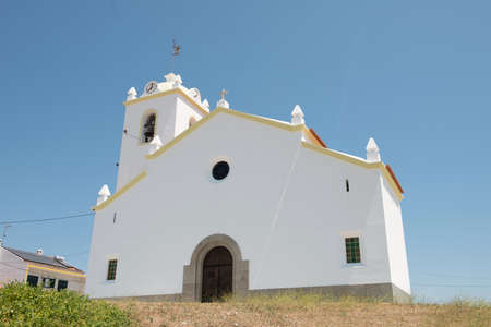 The tiny country Church of Sao Bento sits atop a small hilltop in the Alentejo town of Azaruja Stock Photo