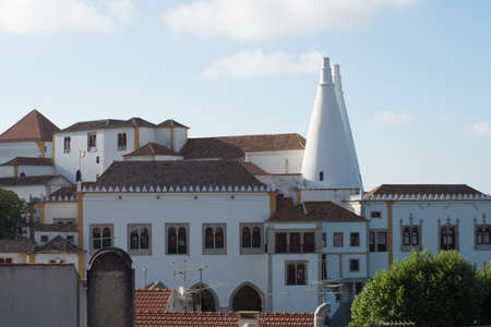 The chimney spiers of the National Palace of Sintra dominate Sintras skyline. Sintra, Portugal.