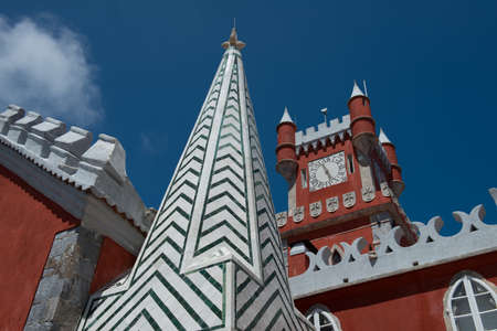 A closeup view of the chapel steeple and clocktower of the Pena National Palace. Sintra, Portugal.
