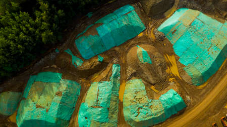 Tons of high grade ore from strip mining sit under tarpaulins Фото со стока