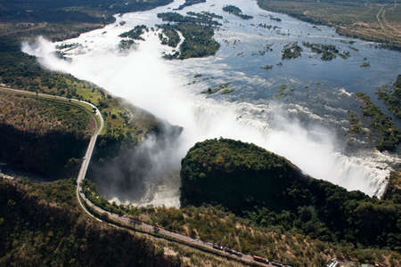 Spectacular areial view of victoria falls showing the zambezi river in full flood and the bridge crossing photo