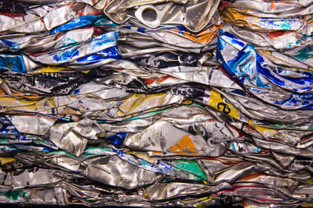 discarded metal: a close up of metal drink cans squashed for recycling Stock Photo