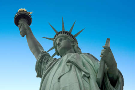 patriotic america: Statue of liberty with a blue sky background Stock Photo