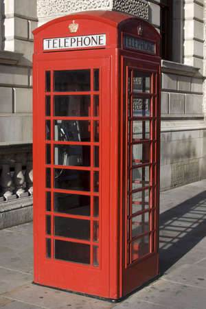 British Red phone box with the word telephone across the top Stock Photo - 6129755