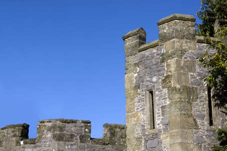 battlements: norman battlements and tower against a blue sky in the UK Stock Photo