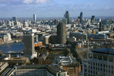 An aerial of London showing St Pauls Cathedral the Natwest Tower the Gherkin and the River Thames photo