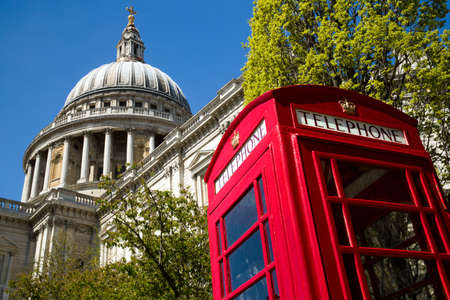 A red London phone box with the dome of St Paul photo