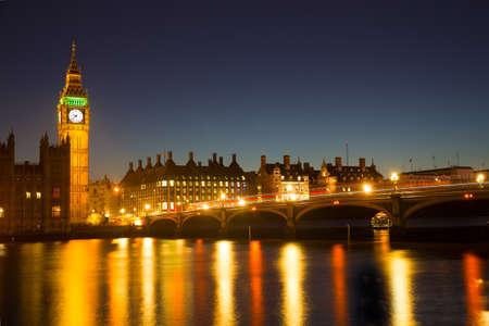 Reflection of Westminster Bridge and the Elizabeth Tower Big Ben of the Palace of Westminster in the River Thames