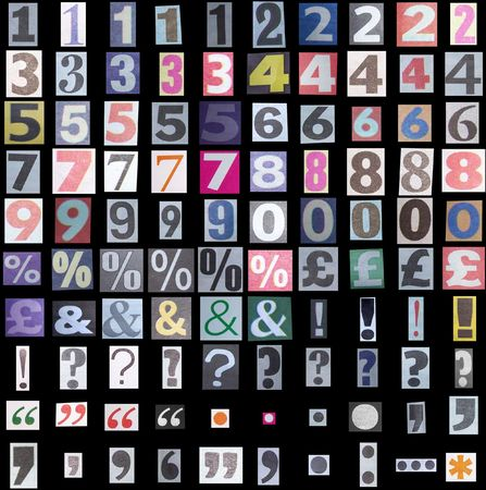 Newspaper symbols and numbers on black background Stock Photo - 1843605