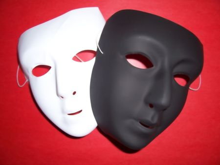 dilate: photo of two masks over a red background with dilate blur effect  Stock Photo