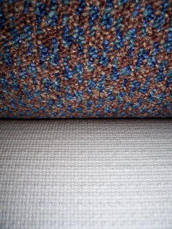 underlay: Close-up foto de una alfombra texturada que muestra otro rollo de la parte inferior