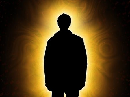 man shadow: Person looking into light or standing in front of light looking forward