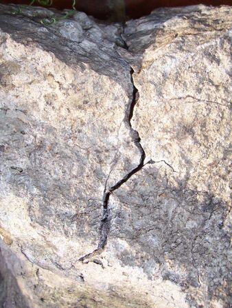 foundation cracks: Rock with big crack running through it Stock Photo